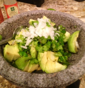 Chopped avocado, cilantro and onion.