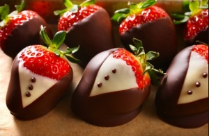 Dark chocolate dipped strawberries are another of my chocolate laden indulgences. Since the chocolate covers fruit it's even healthier! Win-win!