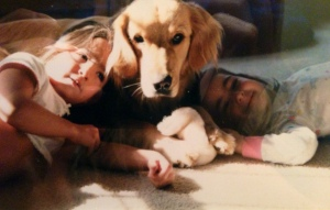 My first dog, Princess, with my girls when they were little! They loved cuddling with her!