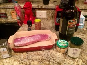 Pork tenderloin, garlic, herbs de province, EVOO, and basil pesto ready to go!