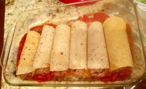 Roll the enchiladas and place them in the pan.